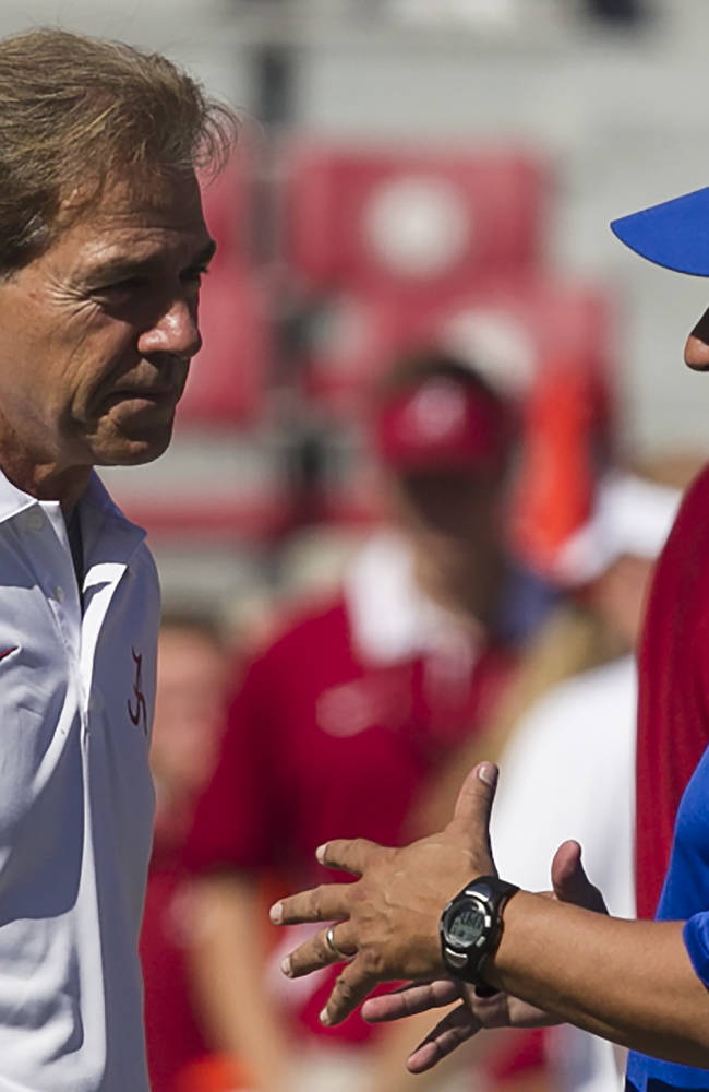 Alabama head coach Nick Saban talks with Georgia State head coach Trent Miles before the first half of an NCAA college football game on Saturday, Oct. 5, 2013, in Tuscaloosa, Ala
