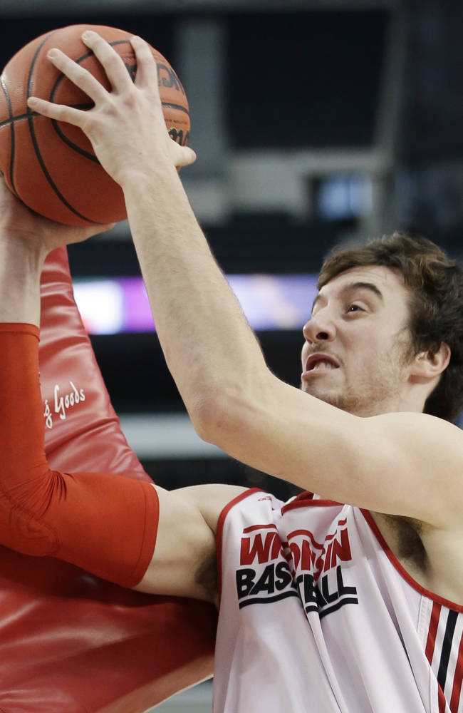 Wisconsin forward Frank Kaminsky drills during practice for an NCAA Final Four tournament college basketball semifinal game Friday, April 4, 2014, in Dallas. Wisconsin plays Kentucky on Saturday, April 5, 2014