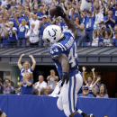 Indianapolis Colts running back Ahmad Bradshaw celebrates a touchdown against the Tennessee Titans during the second half of an NFL football game in Indianapolis, Sunday, Sept. 28, 2014. The Associated Press