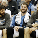 Minnesota Timberwolves' Ricky Rubio, left, of Spain, Kevin Love, center, and Nikola Pekovic, of Montenegro, enjoy the fourth quarter on the bench as the Timberwolves beat the Brooklyn Nets 111-81 in an NBA basketball game, Friday, Nov. 22, 2013, in Minnea