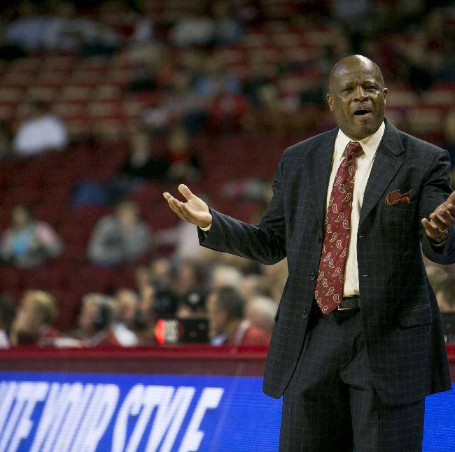 Arkansas head coach Mike Anderson questions a call during the second half of an NCAA college basketball game agaisnt Savannah State in Fayetteville, Ark., Thursday, Dec. 12, 2013. Arkansas defeated Savannah State 72-43