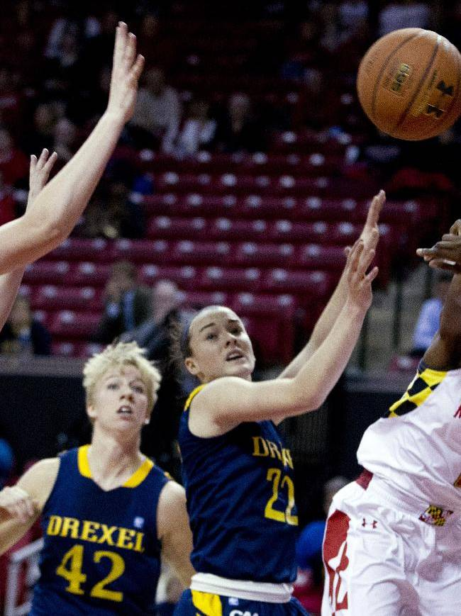 Maryland's Laurin Mincy (1) passes the ball as Drexel's Sarah Curran (5) and Meghan Creighton (22) try to block, during the first half of an NCAA college basketball game at the Comcast Center in College Park, Md., Monday, Nov. 25, 2013