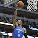 Oklahoma City Thunder guard Russell Westbrook (0) drives against Dallas Mavericks guard Jose Calderon (8), of Spain, during the first half of an NBA basketball game Tuesday, March 25, 2014, in Dallas. Westbrook was called for the charge on the play The As