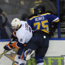 St. Louis Blues' Ryan Reeves (75) checks New York Islanders' Nick Leddy (2) during the second period of an NHL hockey game, Thursday, Dec. 11, 2014, in St. Louis The Associated Press