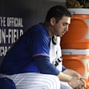 New York Mets starting pitcher Matt Harvey sits in the dugout in the sixth inning of a baseball game against the Miami Marlins at Citi Field on Friday, May 29, 2015, in New York. (AP Photo/Kathy Kmonicek)
