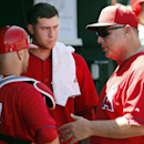 Los Angeles Angels manager Mike Scioscia, right, talks with starting pitcher Tyler Skaggs and catcher Chris Iannetta, left, prior to a spring training baseball game against the San Francisco Giants on Monday, March 24, 2014, in Tempe, Ariz The Associated
