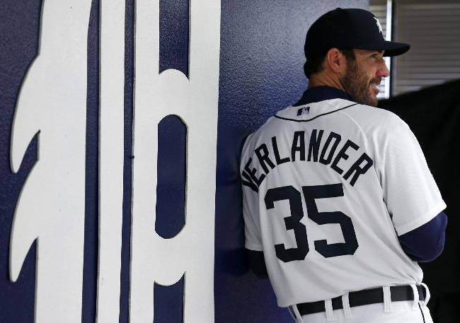 Detroit Tigers starting pitcher Justin Verlander (35) poses for a photographer during the team's baseball spring training photo day Sunday, Feb. 23, 2014. in Lakeland, Fla