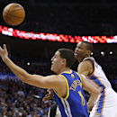 Golden State Warriors guard Klay Thompson (11) and Oklahoma City Thunder guard Russell Westbrook chase a loose ball in the first quarter of an NBA basketball game in Oklahoma City, Friday, Nov. 29, 2013 The Associated Press