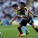 Newcastle United's Remy Cabella, right, vies for the ball with Crystal Palace's Martin Kelly, left, during their English Premier League soccer match at St James' Park, Newcastle, England, Saturday, Aug. 30, 2014