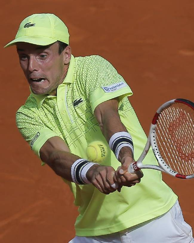 Roberto Bautista Agut returns the ball during a Madrid Open tennis tournament semifinal match against Rafael Nadal from Spain in Madrid, Spain, Saturday May 10, 2014