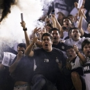 Paraguay Olimpia soccer fans cheer during the first leg of the Copa Libertadores final against Brazil Atletico Mineiro in Asuncion, Paraguay, Wednesday, July 17, 2013. (AP Photo/Jorge Saenz)