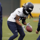 Seattle Seahawks' Richard Sherman runs drills during a team practice for NFL Super Bowl XLIX football game, Thursday, Jan. 29, 2015, in Tempe, Ariz. The Seahawks play the New England Patriots in Super Bowl XLIX on Sunday, Feb. 1, 2015 The Associated Press