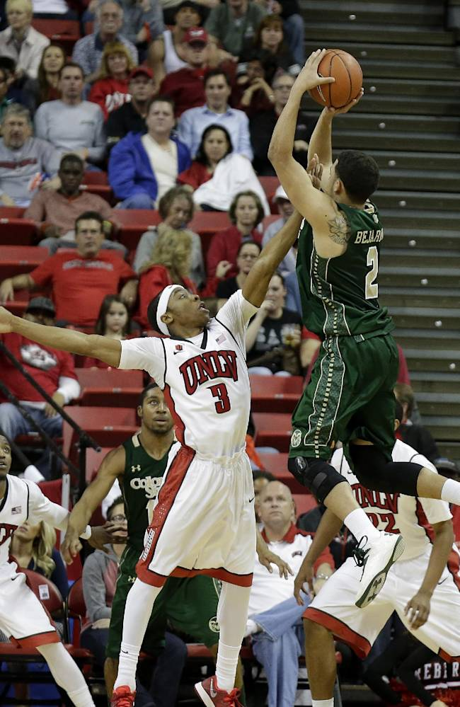 UNLV's Kevin Olekaibe covers a shot from Colorado State's Daniel Bejarano during the second half of an NCAA college basketball game on Wednesday, Feb. 26, 2014, in Las Vegas. UNLV defeated Colorado State 78-70