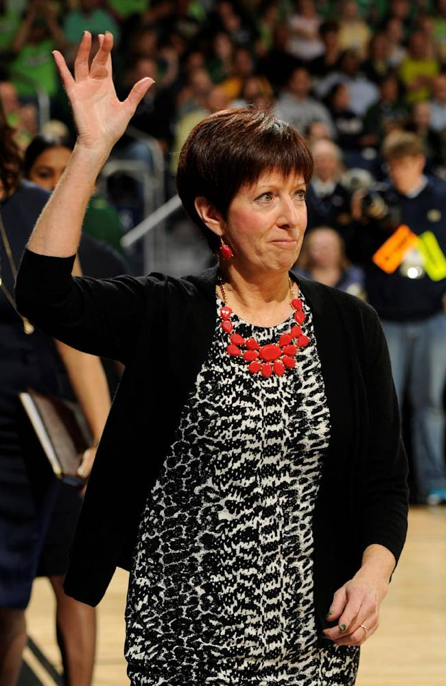 Notre Dame coach Muffet McGraw waves to the crowd prior to the first half of their NCAA women's college basketball tournament regional final game at the Purcell Pavilion in South Bend, Ind Monday March 31, 2014