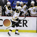 Boston Bruins' Patrice Bergeron is congratulated by the bench after his empty net goal during the third period of Game 3 of a first-round NHL hockey playoff series against the Detroit Red Wings in Detroit, Tuesday, April 22, 2014 The Associated Press