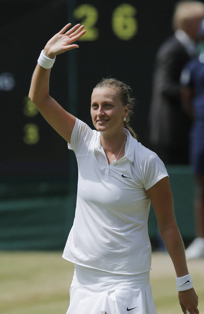 Petra Kvitova of Czech Republic celebrates defeating Lucie Safarova of Czech Republic after their women's singles semifinal match at the All England Lawn Tennis Championships in Wimbledon, London, Thursday, July 3, 2014