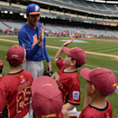 New York Mets' John Lannan greets Little League players on the field before a baseball game against the Los Angeles Angels in Anaheim, Calif., Sunday, April 13, 2014 The Associated Press