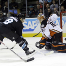 San Jose Sharks' Joe Pavelski (8) scores past Anaheim Ducks goalie Ilya Bryzgalov during the first period of an NHL hockey game Thursday, Jan. 29, 2015, in San Jose, Calif The Associated Press