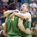 Oregon's E.J. Singler, right, and Arsalan Kazemi celebrate defeating UCLA 78-69 in the championship NCAA college basketball game in the Pac-12 Conference tournament, Saturday, March 16, 2013, in Las Vegas. (AP Photo/Julie Jacobson)