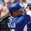Kansas City Royals' Billy Butler hits an RBI single during the first inning of a spring exhibition baseball game against the Los Angeles Angels, Thursday, March 20, 2014, in Surprise, Ariz The Associated Press