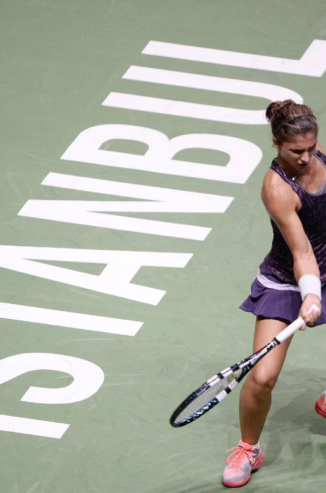 Sara Errani of Italy returns a shot to Victoria Azarenka of Belarus during their tennis match at the WTA championship in Istanbul, Turkey, Tuesday, Oct. 22, 2013. (AP Photo)