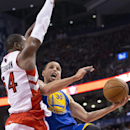 Golden State Warriors' Stephen Curry goes to the basket against Toronto Raptors' Patrick Patterson during the second half of an NBA basketball game in Toronto on Sunday, March 2, 2014 The Associated Press