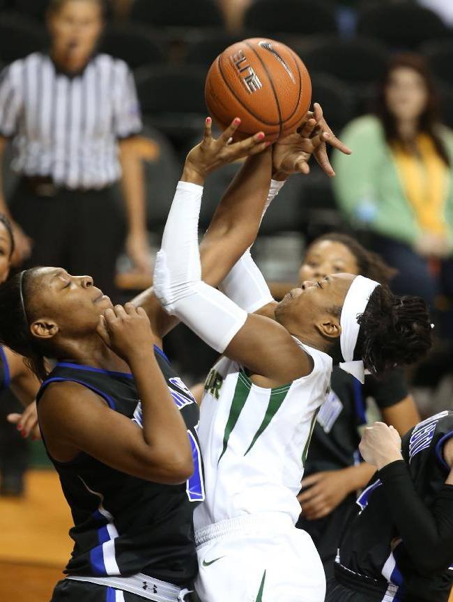 Baylor's Odyssey Sims, right, is fouled by Oklahoma City's Tommitrise Collins during the first half of an NCAA college basketball exhibition game, Tuesday, Nov. 5, 2013, in Waco, Texas