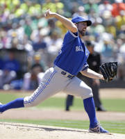 Toronto Blue Jays starting pitcher R.A. Dickey throws against the Oakland Athletics during the first inning of a baseball game on Wednesday, July 31, 2013, in Oakland, Calif. (AP Photo/Eric Risberg)