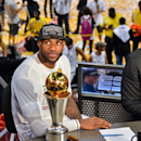 MIAMI, FL - JUNE 20: LeBron James #6 of the Miami Heat waits to be interviewed while sitting with the Bill Russell NBA Finals Most Valuable Player (MVP) trophy following the Heat's victory against the San Antonio Spurs in Game Seven of the 2013 NBA Finals on June 20, 2013 at American Airlines Arena in Miami, Florida. (Photo by Jesse D. Garrabrant/NBAE via Getty Images)