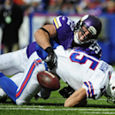 Buffalo Bills wide receiver Chris Hogan (15) fumbles the ball as he is tackled by Minnesota Vikings' Chad Greenway (52) during the first half of an NFL football game Sunday, Oct. 19, 2014, in Orchard Park, N.Y The Associated Press