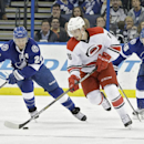 Carolina Hurricanes center Elias Lindholm (16) starts the breakout after getting past Tampa Bay Lightning right wing Ryan Callahan (24) and defenseman Matt Carle (25) during the first period of an NHL hockey game Thursday, Dec. 11, 2014, in Tampa, Fla The