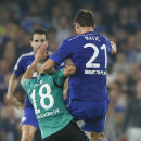 Schalke's Sidney Sam is pushed by Chelsea's Nemanja Matic, right, during the Champions League group G soccer match between Chelsea and Schalke 04 at Stamford Bridge stadium in London, Wednesday, Sept. 17, 2014