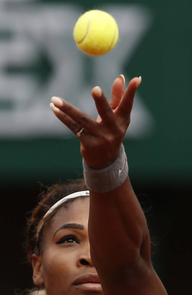 Serena Williams of the U.S, serves the ball to France's Alize Lim during the first round match of  the French Open tennis tournament at the Roland Garros stadium, in Paris, France, Sunday, May 25, 2014. Williams won 6-2, 6-1