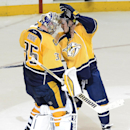 Nashville Predators goalie Pekka Rinne (35), of Finland, is congratulated by Mike Ribeiro (63) after defeating the Boston Bruins 3-2 during a shootout at an NHL hockey game Tuesday, Dec. 16, 2014, in Nashville, Tenn The Associated Press