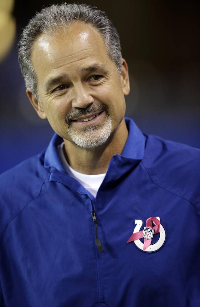 This is an Oct. 6, 2013 photo showing Indianapolis Colts head coach Chuck Pagano, wearing a ribbon to promote breast cancer awareness, before an NFL football game against the San Diego Chargers in Indianapolis. Pagano has kept it loose this week leading to the wild-card game with the Chiefs. He's cracking jokes, encouraging laughter and putting football in perspective. He doesn't want this game to change anything, so he's imploring his players to be themselves