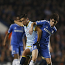 Chelsea's Oscar, right, shields the ball from Bucharest's Gabriel Iancu during the Champions League Group E soccer match between Chelsea and Steaua Bucharest at Stamford Bridge Stadium in London Wednesday, Dec. 11, 2013