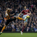 West Ham's James Tomkins, right, competes for the ball with Hull City's Jake Livermore during the English Premier League soccer match between West Ham and Hull City at Upton Park stadium in London, Sunday, Jan. 18, 2015