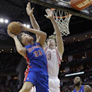 Detroit Pistons forward Jonas Jerebko (33) is met at the basket by Houston Rockets' Omer Asik (3) during the first half of an NBA basketball game, Saturday, March 1, 2014, in Houston The Associated Press