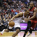 Milwaukee Bucks' Ramon Sessions, left, drives against Miami Heat's James Jones during the second half of an NBA basketball game Saturday, March 29, 2014, in Milwaukee The Associated Press