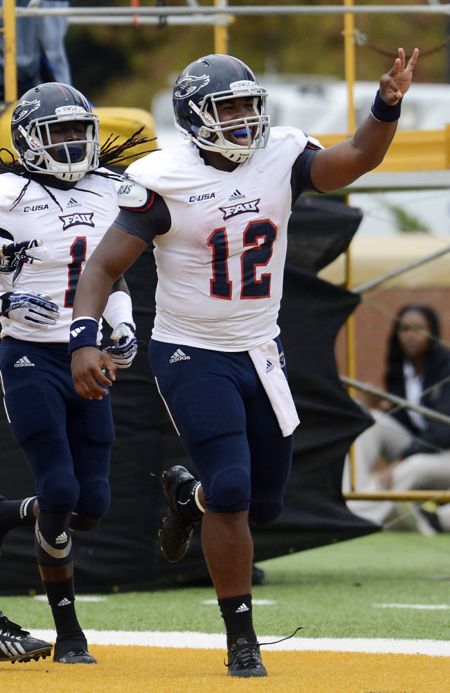 Florida Atlantic quarterback Jaquez Johnson (12) celebrates after scoring a touchdown in the second quarter of an NCAA college football game in Hattiesburg, Miss., Saturday, Nov. 16, 2013