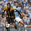 Manchester City's Matija Nastasic, right, fights for the ball against Hull's Danny Graham, during their English Premier League soccer match at The Etihad Stadium, Manchester, England, Saturday Aug. 31, 2013. (AP Photo/Jon Super)