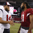 Houston Texans quarterback Ryan Fitzpatrick (14) talks with Arizona Cardinals wide receiver Larry Fitzgerald after an NFL preseason football game, Saturday, Aug. 9, 2014, in Glendale, Ariz. The Cardinals won 32-0 The Associated Press