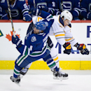 Buffalo Sabres' Nikita Zadorov, back, of Russia, checks Vancouver Canucks' Chris Tanev during the third period of an NHL hockey game Friday, Jan. 30, 2015, in Vancouver, British Columbia The Associated Press