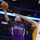 Sacramento Kings center DeMarcus Cousins, left, put-up a shot as Los Angeles Lakers center Pau Gasol, of Spain, defends during the second half of an NBA basketball game Sunday, Nov. 24, 2013, in Los Angeles The Associated Press