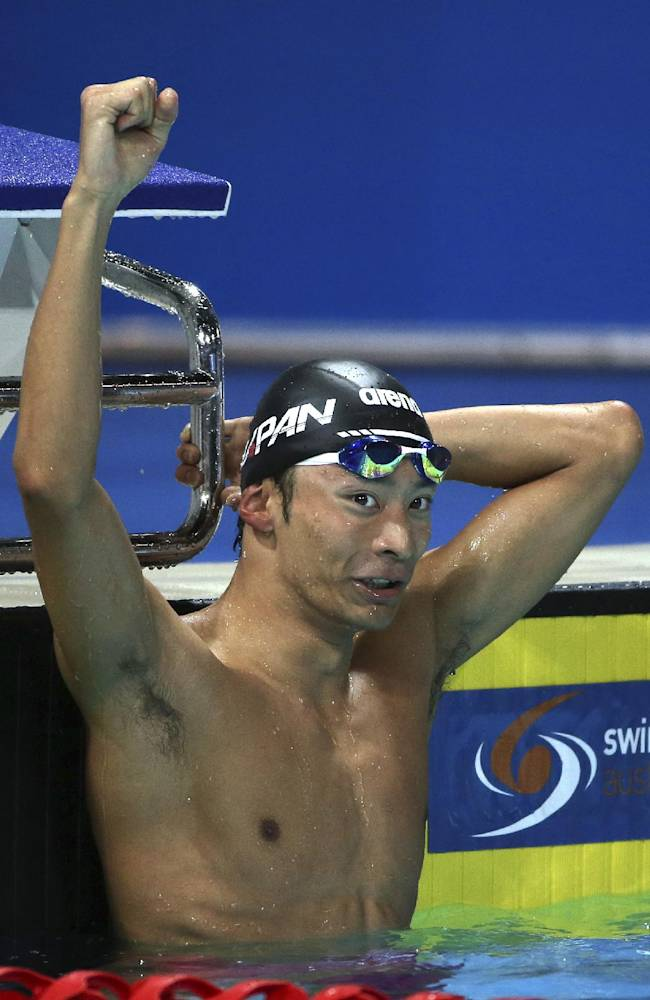 Irie Ryosuke of Japan holds his fist in the air after winning his men's 100m backstroke final at the Pan Pacific swimming championships in Gold Coast, Australia, Thursday, Aug. 21, 2014. Ryosuke finished ahead of U.S. swimmers Matt Grevers and Ryan Murphy