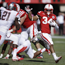 Nebraska running back Terrell Newby (34) runs away from Rutgers defensive back Lorenzo Waters (21) in the second half of an NCAA college football game in Lincoln, Neb., in this Oct. 25, 2014 file photo. The Huskers lost at Michigan State and could draw a