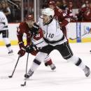 Los Angeles Kings' Mike Richards (10) shoots the puck as he scores against the Arizona Coyotes as Coyotes' Brandon Gormley (33) defends during the first period of a preseason NHL hockey game Monday, Sept. 22, 2014, in Glendale, Ariz. (AP Photo/Ross D. Franklin)