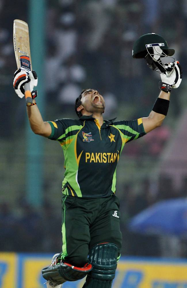Pakistan's Umar Akmal celebrates after scoring a century during the Asia Cup one-day international cricket tournament against Afghanistan in Fatullah, near Dhaka, Bangladesh, Thursday, Feb. 27, 2014