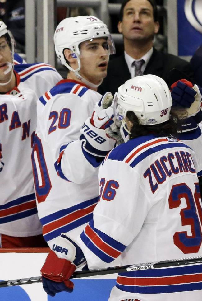 New York Rangers' Mats Zuccarello (36) celebrates with teammates after scoring a goal  during the first period of an NHL hockey game against the Chicago Blackhawks in Chicago, Wednesday, Jan. 8, 2014