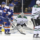 Dallas Stars goalie Anders Lindback (29), of Sweden, makes a save as New York Islanders left wing Nikolai Kulemin (86), of Russia, and center Mikhail Grabovski, of Germany, left, look on during the first period of their NHL hockey game, Saturday, Oct. 25